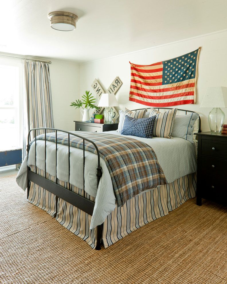 Proper Way to Hang the American Flag   Farmhouse Bedroom  and American Flag Black Dresser Glass Table Lamps Metal Bed Frame Plaid Duvet Cover Railroad Sign Striped Bedskirt Striped Curtains