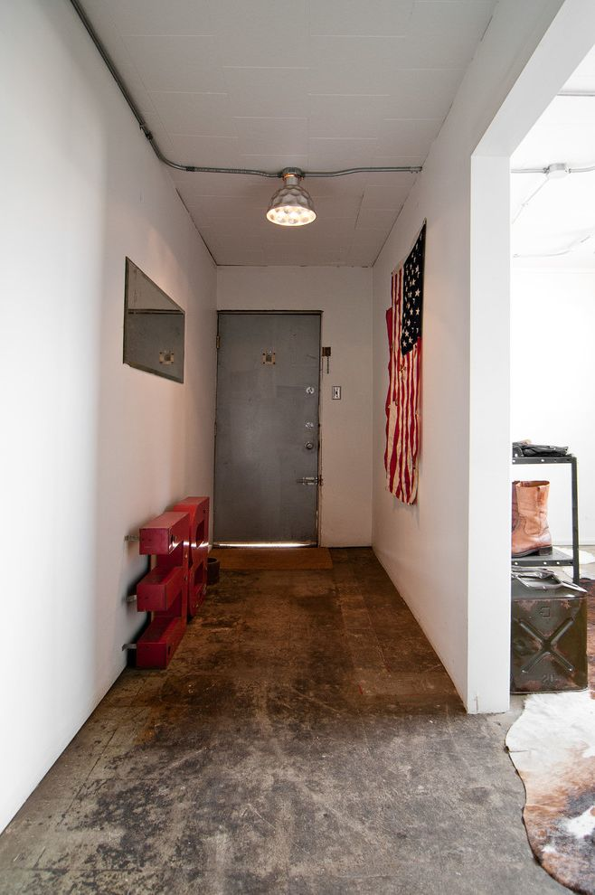 Proper Way to Hang the American Flag   Industrial Entry  and Antique Concrete Floor Cow Hide Exposed Electrical Industral Living Steel Door Vintage White Walls