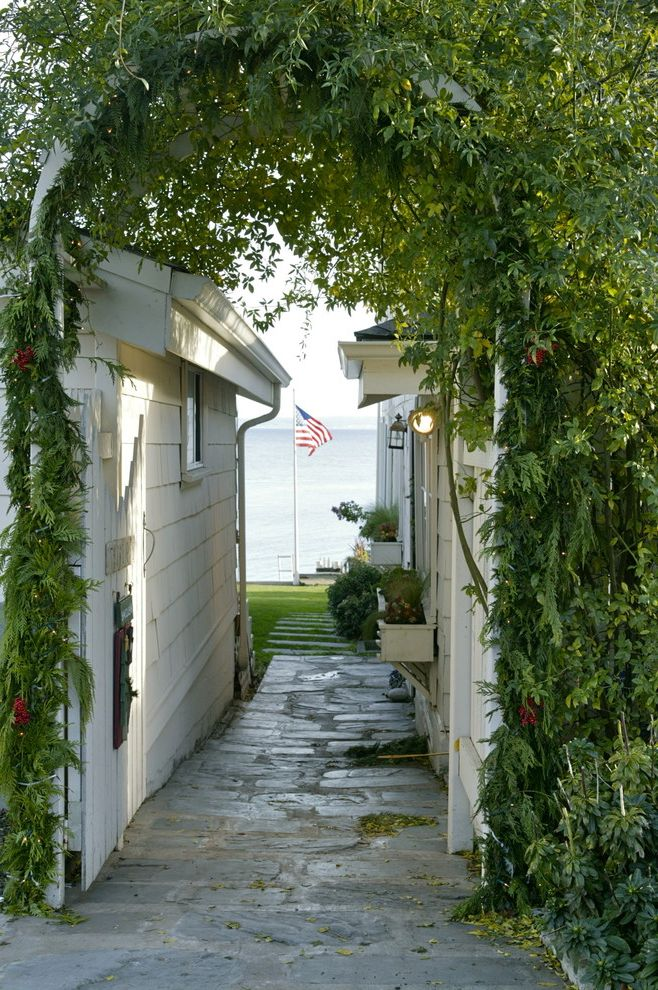 Proper Way to Hang the American Flag with Beach Style Landscape  and American Flag Arbor Beach Cottage Flagstone Patio Flower Box Grass Lawn Shingle Siding Walkway Water View White Painted Wood