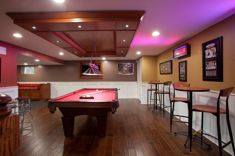 Pub Table Sets Cheap with Contemporary Basement  and Bar Bar Stools Basement Flooring Brown Chair Molding Home Theatre Lighting Man Cave Neon Ochre Paint Colors Pool Table Recessed Lights Red Tiles Tray Ceiling Tv Wainscot Wood Floor