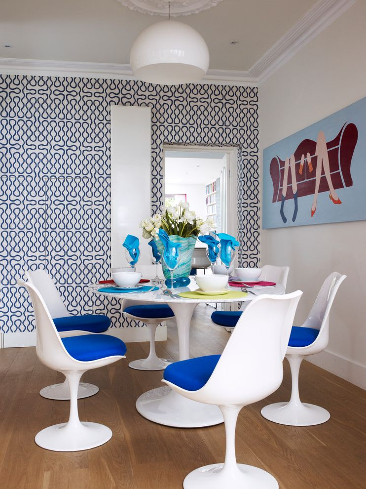 Pub Table Sets Cheap with Contemporary Dining Room  and Artwork Blue Blue and White Dinner Table Setting Feature Wall Moulded Chairs Saarinen Squiggle Table Setting Tulip Chairs Wall Art Wallpaper White Dining Chairs Wood Flooring Wooden Floor