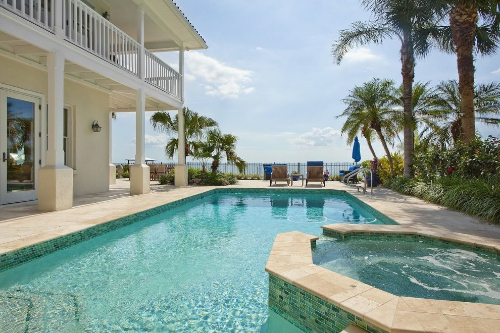 Public Pools in Tampa   Traditional Pool  and Blue Cushions Glass Tile Hot Tub Mosaic Pool Tile Outdoor Chaise Lounge Outdoor Lighting Outdoor Umbrella Palm Tree Pool Pool Tile Spa Stone Columns Stone Patio White Glass Doors White Pillars White Railing