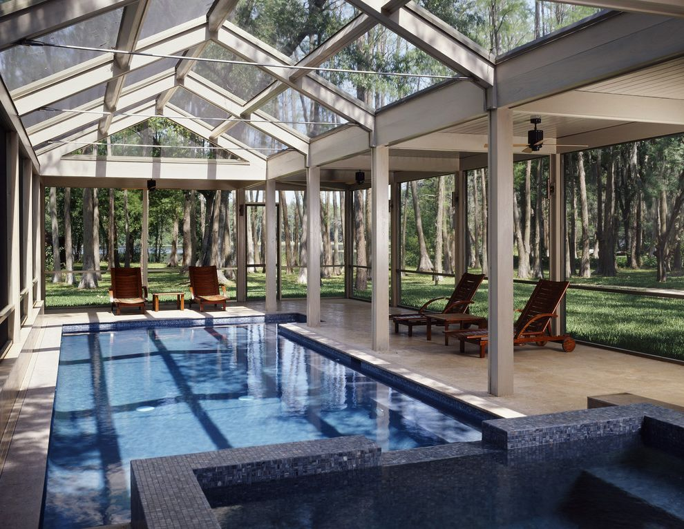 Public Pools in Tampa with Contemporary Pool  and Blue Mosaic Tile Blue Pool Tile Covered Pool Enclosed Pool Forest Setting Indoor Outdoor Outdoor Chaise Lounges Rectilinear Pool and Spa Small Swimming Pool View Wheeled Pool Chairs