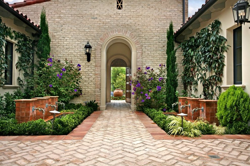 Purple Flowers Names with Mediterranean Landscape  and Brick Centerpiece Container Plant Courtyard Cypress Entry Formal Fountain Lantern Outdoor Lighting Pass Through Path Patio Planter Pond Potted Plant Stone Tile Walkway Wall Lighting Water Feature