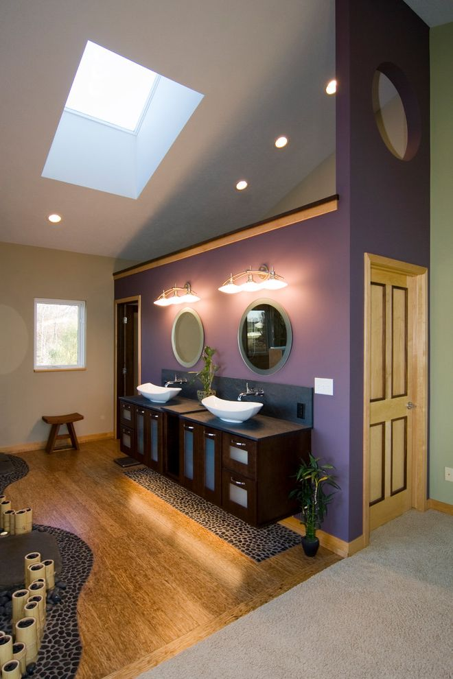 Purple Vessel Sinks with Asian Bathroom  and Bamboo Bath Bathroom Color Dark Stained Wood Vanity Double Vanity Frosted Glass Green Mixture of Materials Purple Accent Wall Round Mirrors Sky Light Spa Retreat Stool Vaulted Ceiling Vessel Sinks Wood Floor