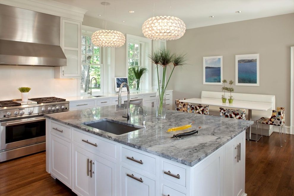 Quartzite vs Granite   Contemporary Kitchen Also Banquette Breakfast Nook Ceiling Lighting Eat in Kitchen Gray Walls Island Lighting Kitchen Island Kitchen Table Rage Hood Recessed Lighting Stainless Steel Appliances White Kitchen Wood Flooring