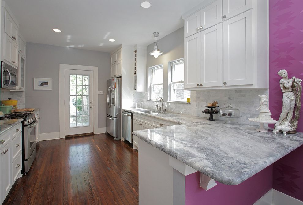 Quartzite vs Granite   Eclectic Kitchen  and Cakestand Glass Paned Door Gray Hardwood Floor Marble Like Granite Pendant Light Purple Raspberry Shaker Cabinets Statue Tile Backsplash White Cabinets