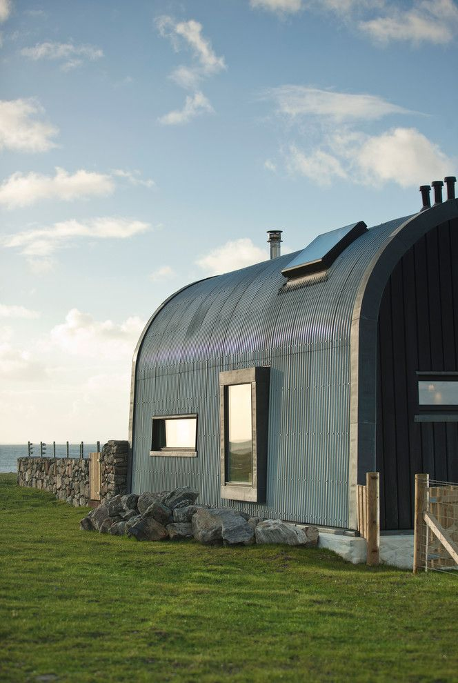Quonset Hut for Sale   Industrial Exterior  and Coastal Home Contemporary House Corrugated Iron Corrugated Metal Curved Roof Industrial Outer Hebrides Riba Scotland Scottish House Sea View Skylight Sleek Stone Stone Wall