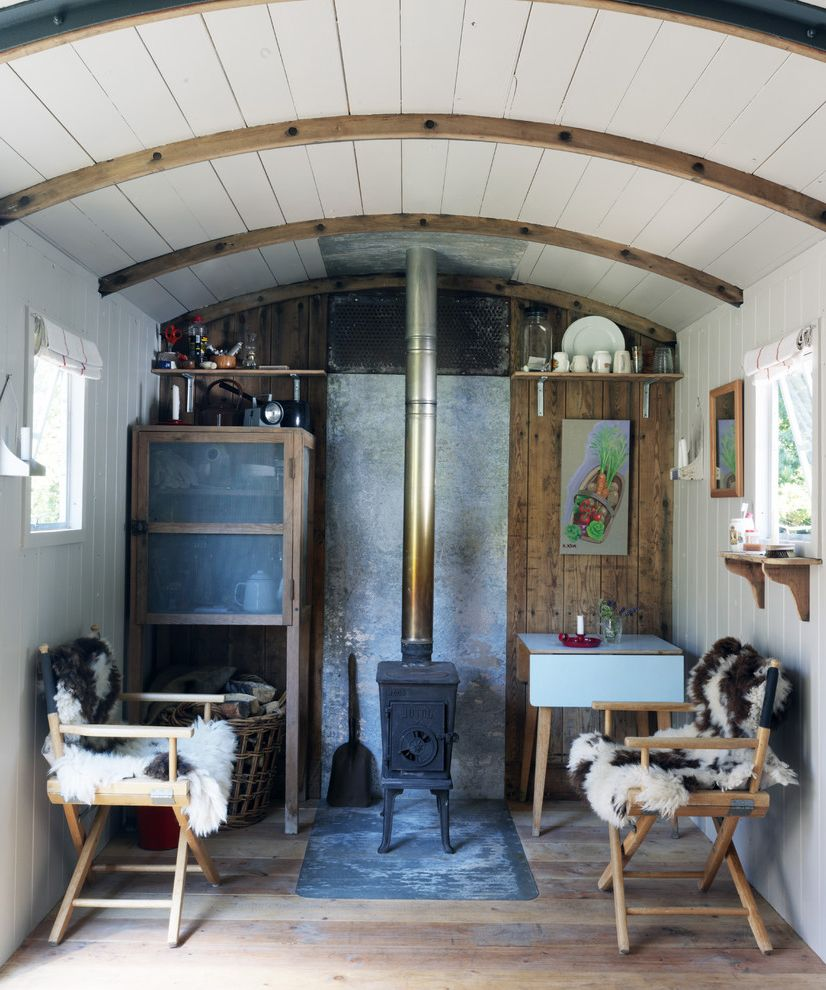 Quonset Hut for Sale   Shabby Chic Style Living Room  and Beadboard Chair Curved Ceiling Fireplace Pine Rustic Rustic Wood Floor Table Wood Ceiling Wood Floor