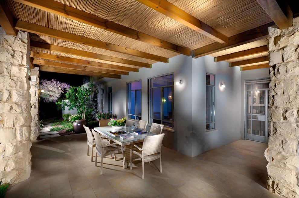 Quonset Hut Kits   Contemporary Patio  and Exposed Beams Geometric Geometry Glass Doors Outdoor Dining Outdoor Lighting Patio Furniture Rock Columns Stone Columns Wall Lighting Wood Ceiling