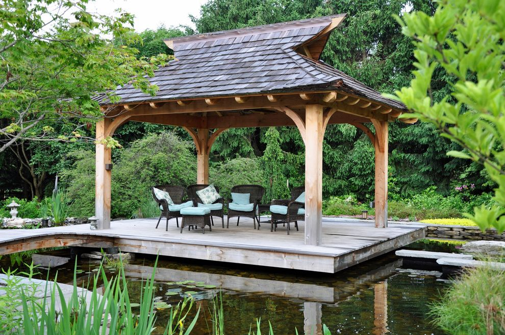 Rachel's Furniture with Asian Deck  and Blue Cushions Deck Footbridge Island Pavilion Koi Pond Landscape Design Landscaping Outdoor Furniture Outdoor Seating Pagoda Pathway Pond Retreat Shingle Roof Stepping Stones Walkway Water Feature Wicker Chairs