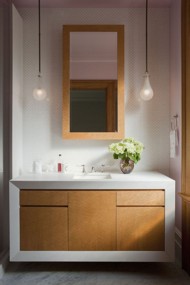 Ralph Pucci Lighting   Modern Bathroom  and Baseboard Flush Cabinets Marble Floor Mini Subway Tile Backsplash Natural Wood Pendant Lights Pink Wood Trim Wood Trimmed Mirror