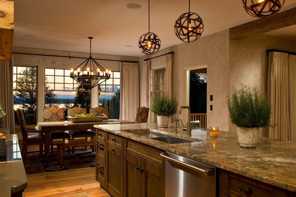 Ralph Pucci Lighting with Rustic Kitchen Also Dark Wood Cabinets Dining Bench Eat in Kitchen Exposed Beams House Plants Island Lighting Kitchen Island Neutral Colors Pendant Lighting Potted Herbs Stainless Steel Appliances Textured Walls Wood Flooring