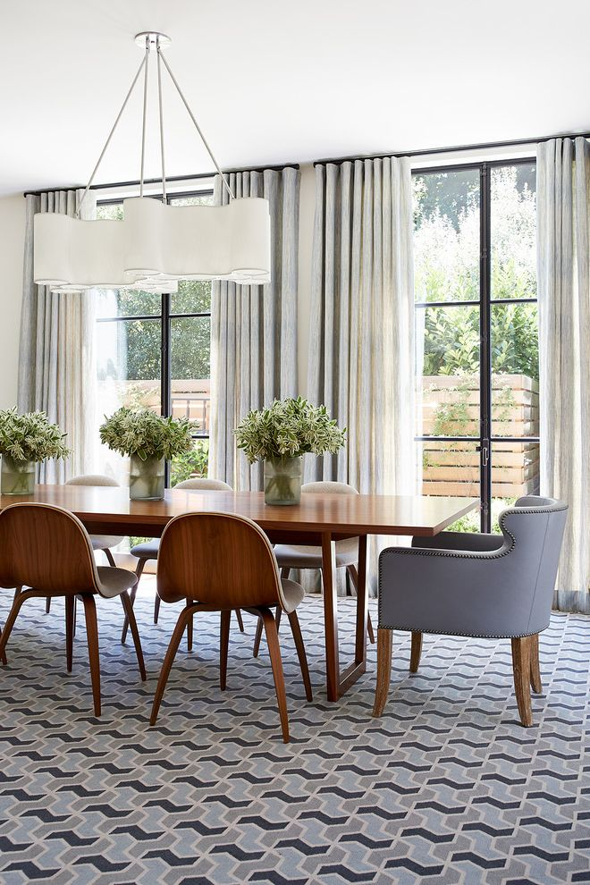 Ralph Pucci Lighting with Transitional Dining Room Also Centerpiece Curtains Dining Chairs Dining Light Fixture Floral Arrangement Geometric Pattern Carpet Glass Doors Vases Wood Dining Table