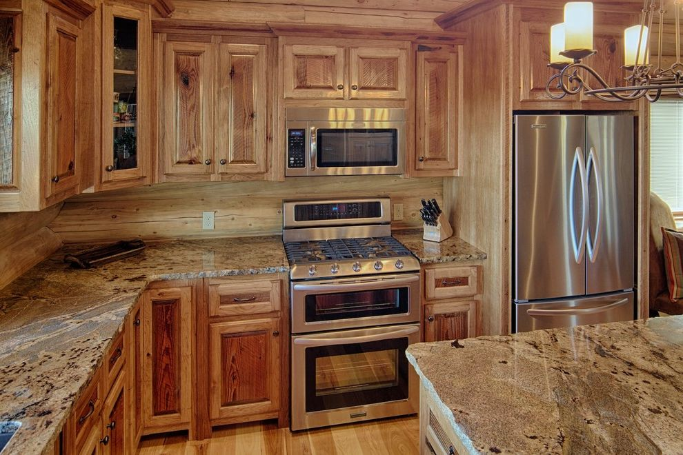 Randall Brothers Atlanta Georgia with Rustic Kitchen  and Chandelier Frame and Panel Glass Front Cabinets Kitchen Island Light Wood Log Backsplash Log Home Raised Panel Rustic Stainless Steel Timber Frame