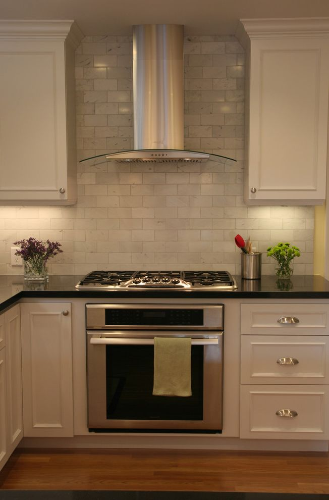 Range Hoods at Lowes with Traditional Kitchen  and Floral Arrangement Kitchen Hardware Range Hood Stainless Steel Appliances Subway Tiles Tile Backsplash Under Cabinet Lighting White Cabinets White Kitchen