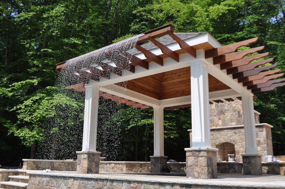 Rani Spa Fairfax with Traditional Patio  and Ipe Pavilion Rain Curtain Water Feature Wood Burning Stone Fireplace