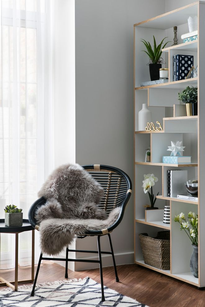 Rattan Bookshelf   Scandinavian Living Room Also Accessorized Bookcase Bamboo Chair Bookcase Accessories Cozy Corner Cozy Nook Fur Throw Gold Accents Gray Walls Medium Wood Floors Reading Corner Succulents White Shelves White Walls Wicker Basket