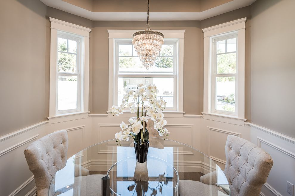 Real Estate Broker Charlotte Nc   Transitional Dining Room  and Bay Windows Chair Rail Crystal Chandelier Gina Covello Linen Dining Chairs Orchids Round Glass Table Tray Ceiling Wainscoting Whereluxurylives