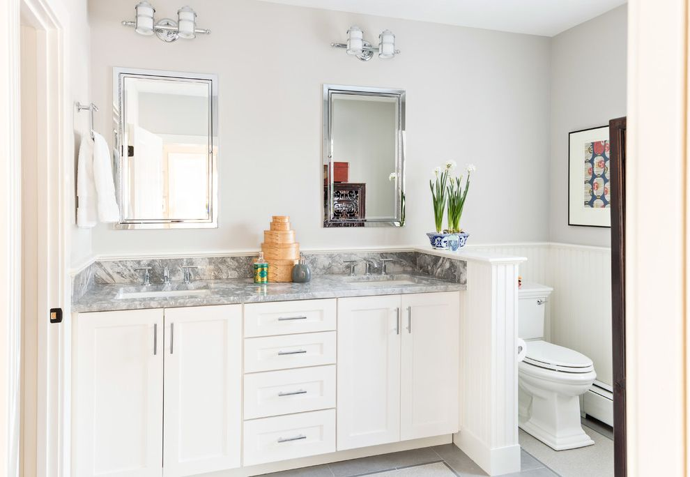 Rear Outlet Toilet   Traditional Bathroom Also Bath Tub Beadboard Wainscoting Double Vanity Marble Counter Nautical Light Skylights Wall Sconces White Bathroom White Cabinets White Wainscoting Widespread Faucet