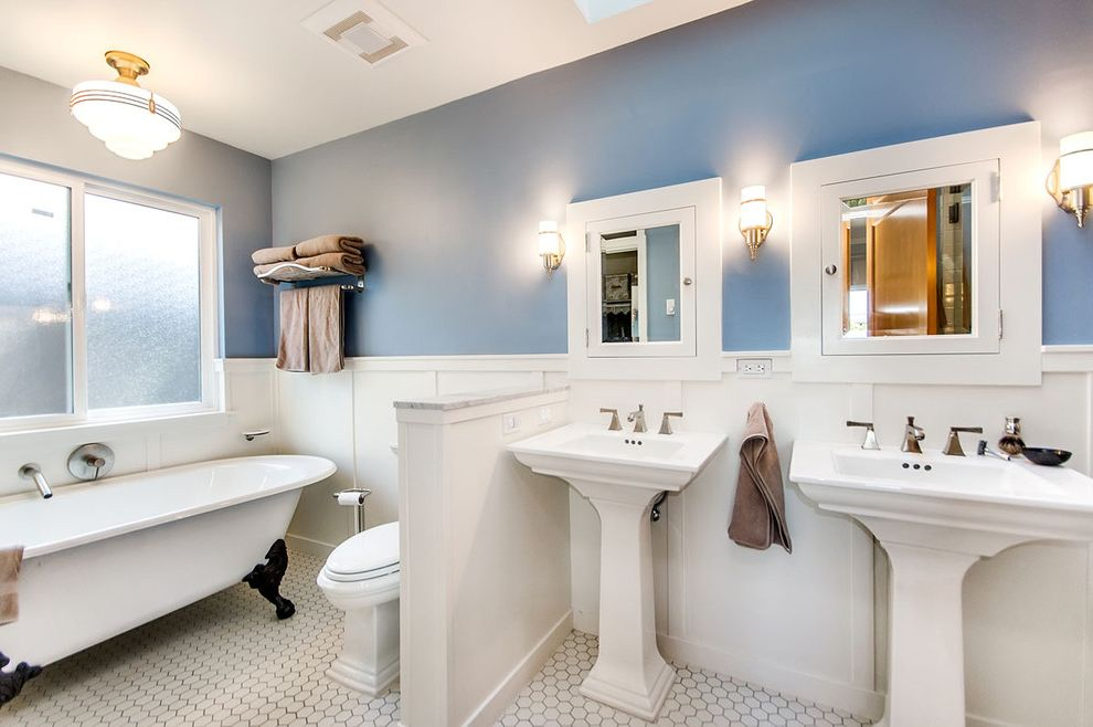 Rear Outlet Toilet with Traditional Bathroom Also Blue Walls Claw Foot Tub Freestanding Tub Gray Grout Hex Tile Pedestal Sinks Recessed Medicine Cabinet Sconce Shared Bathroom Vintage Fixtures Wainscoting Wall Lighting White Wood Wood Trim