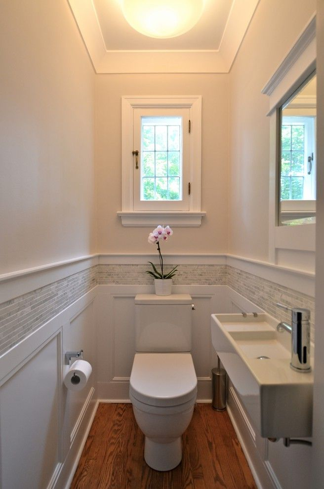Rear Outlet Toilet with Traditional Powder Room  and Bathroom Beige Walls Casement Windows Crown Molding Powder Room Small Space Tile Stripe Wainscoting Wall Mounted Faucet White Trim Wood Floor