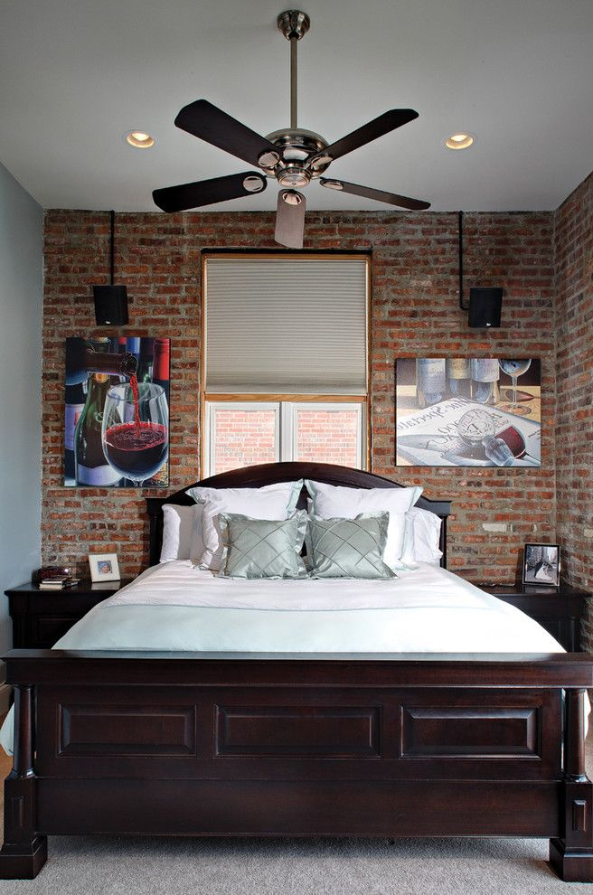 Recessed Light Speaker with Contemporary Bedroom  and Bedside Tables Brick Wall Ceiling Fan Exposed Brick Nighstand Recessed Lighting Speakers Wall Art Wall Decor Wood Bed