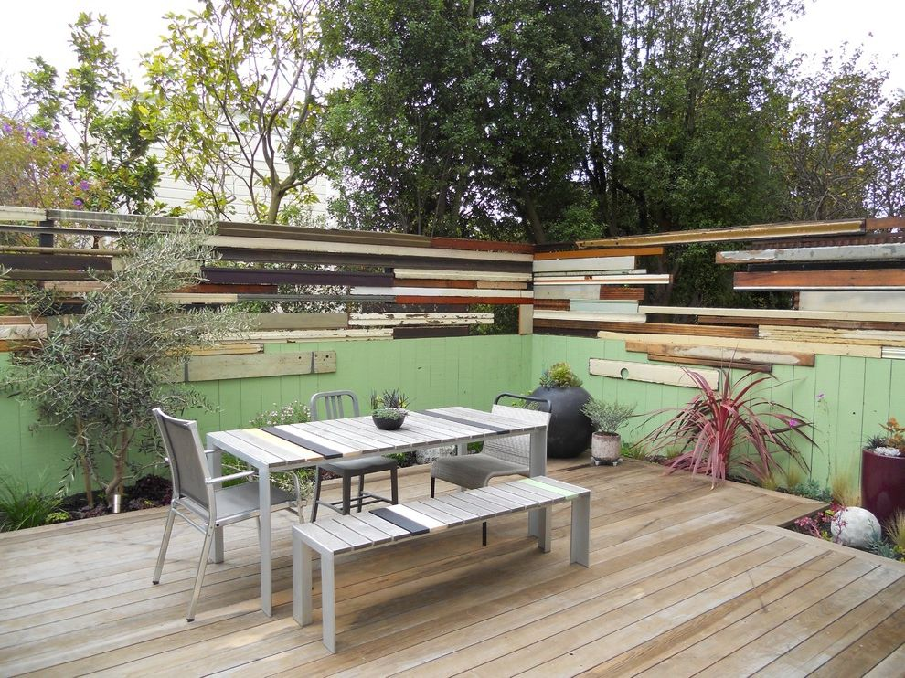 Reclaimed Wood Denver   Contemporary Patio  and Light Green Painted Fence Metal and Wood Dinging Table Mixed Chairs Outdoor Dining Planting Bed Potted Plants Salvaged Wood Fence Wood Deck
