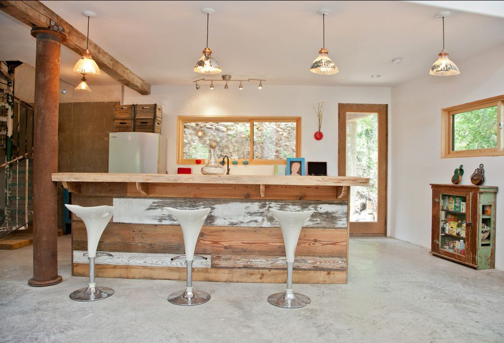 Reclaimed Wood Denver   Rustic Spaces  and Concrete Floor Counter Stools Crates Distressed Paint Kitchen Island Old and New Pendant Lights Rustic Spiral Staircase Steel Post Vintage White Walls Wood Beam Wood Casing