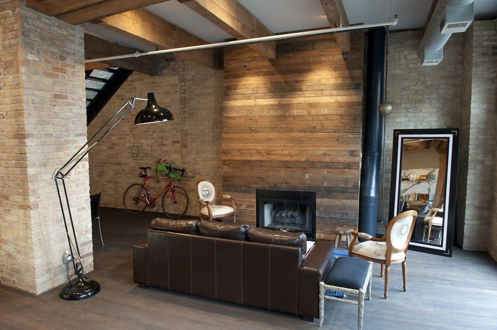 Reclaimed Wood Denver with Rustic Living Room  and Brick Wall Exposed Beams Great Room High Ceilings Leather Sofa Loft Louis Chair Open Floor Plan Oversized Task Lamp Rustic Wood Fireplace Surround Wood Flooring