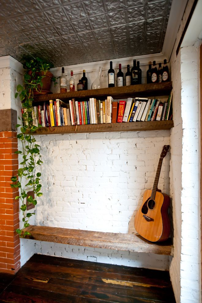 Reclaimed Wood Fort Worth with Rustic Entry  and Bookshelves Brick Fireplace Built in Bench Seat Dark Stained Wood Guitar Open Shelving Painted Brick Rustic Tall Firebox Tin Ceiling Wood Floor