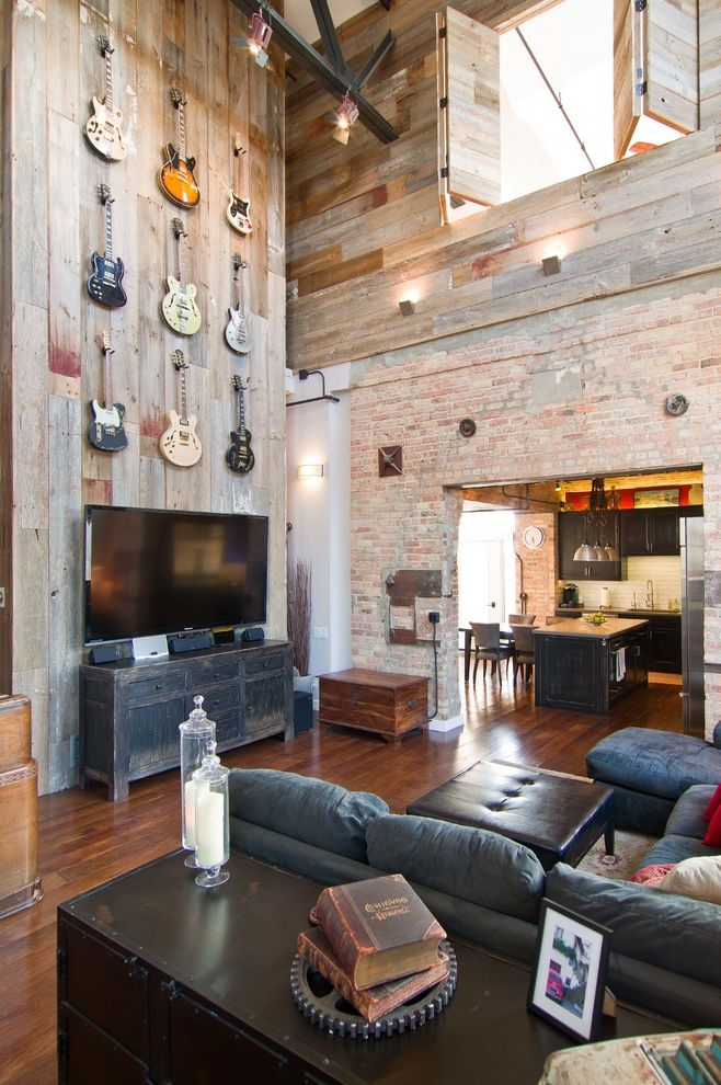 Reclaimed Wood Las Vegas with Industrial Family Room Also Bifold Shutters Blue Couch Ceiling Fans Electric Guitar Display Exposed Brick Flat Screen Tv Guitar Wall Hardwood Floors High Ceiling Multi Story Space Reclaimed Barnwood Two Story Space