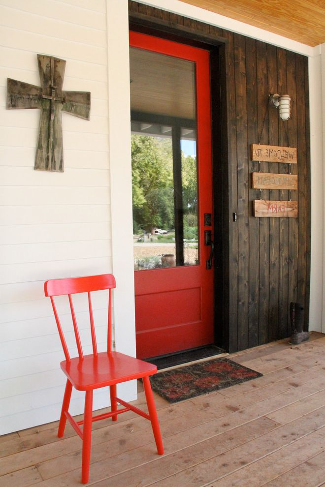 Red Door Consignment   Farmhouse Entry Also Cross Dark Stained Wood Door Entry Mat Front Glass Door Lantern Sconce Red Red Chair Red Door Welcome Sign White Exterior Wood Deck