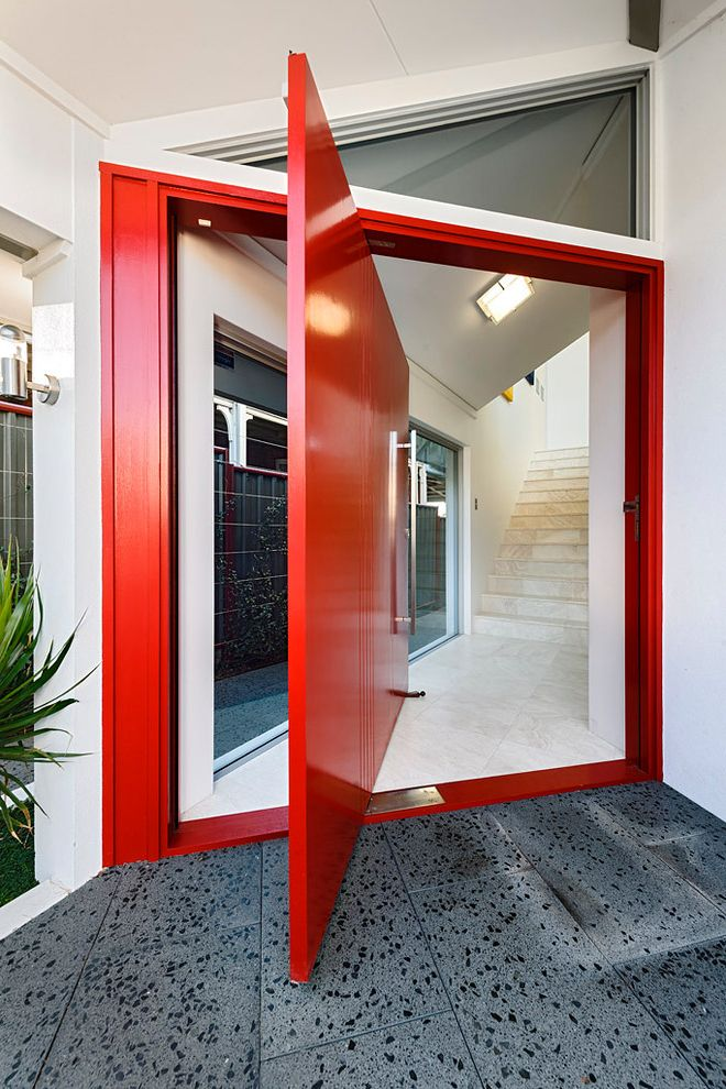 Red Door Consignment   Modern Entry Also Aggregate Large Pivot Front Door Red Door Tile Entry Triangular Transom Window White Cladding White Exterior