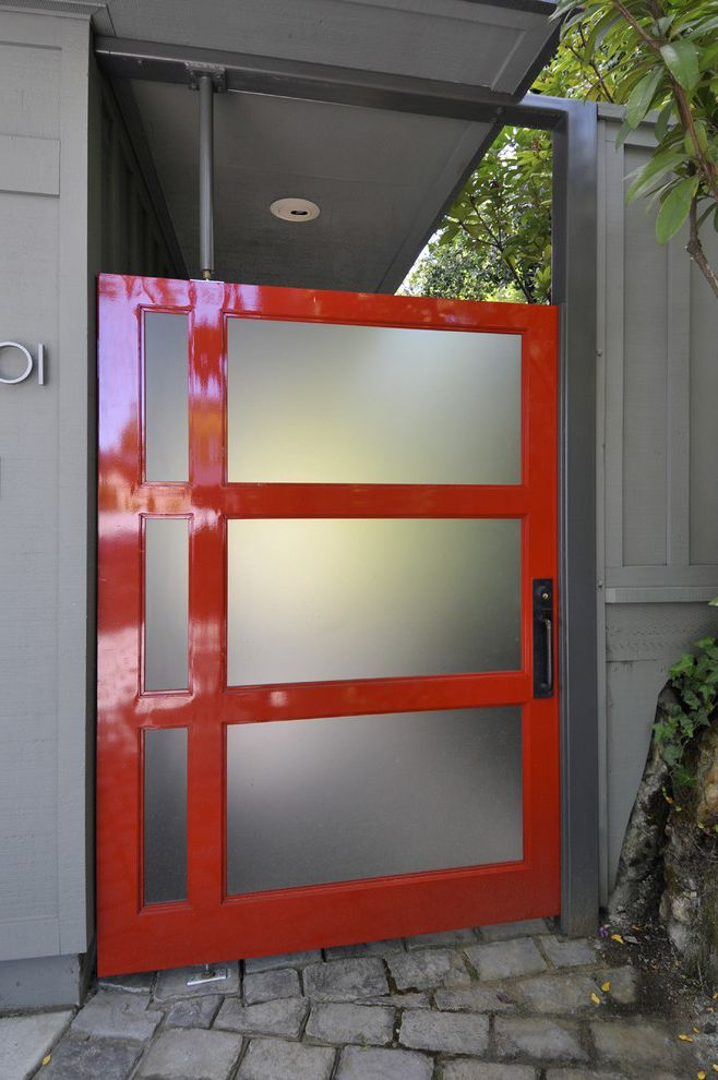 Red Door Dc with Contemporary Entry  and Accent Colors Board and Batten Bold Colors Entry Gate Stone Paving Wood Siding