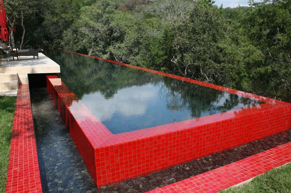 Red Hook Pool with Modern Pool  and Bright Color Disappearing Edge Pool Grass Infinity Pool Lap Pool Lawn Modern Patio Pool Tile Red Rock Tile Turf Vanishing Edge Pool View