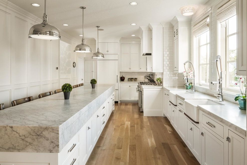 Red Lobster White Oak with Transitional Kitchen  and Ceiling Light Double Sinks Flowers Integrated Fridge Long Kitchen Island Pendant Lighting Range Recessed Lighting Storage Island Vent White Kitchen Window Shades Windows Wood Floors
