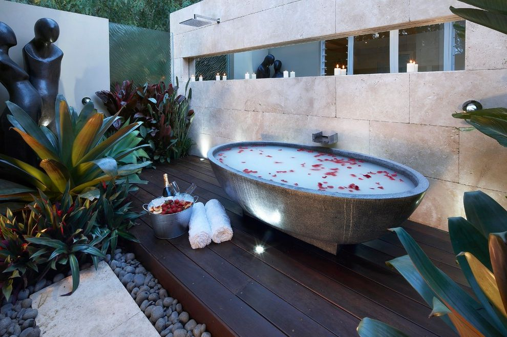 Refined Beauty Day Spa   Contemporary Bathroom Also Candles Concrete Deck Freestanding Tub Frosted Glass Ledge Outdoor Bathroom Oval Bathtub Plants Rain Showerhead Relaxing Ribbon Window River Rocks Sculpture Spa Stones Window Sill