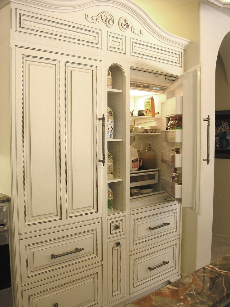 Refrigerator Styles   Traditional Kitchen Also Cabinet Front Refrigerator Carved Wood Cove Lighting Cubbies Distressed Furniture Door Handles Drawer Pulls Faux Finish Kitchen Hardware Panel Refrigerator White Cabinets Wood Cabinets Woodwork