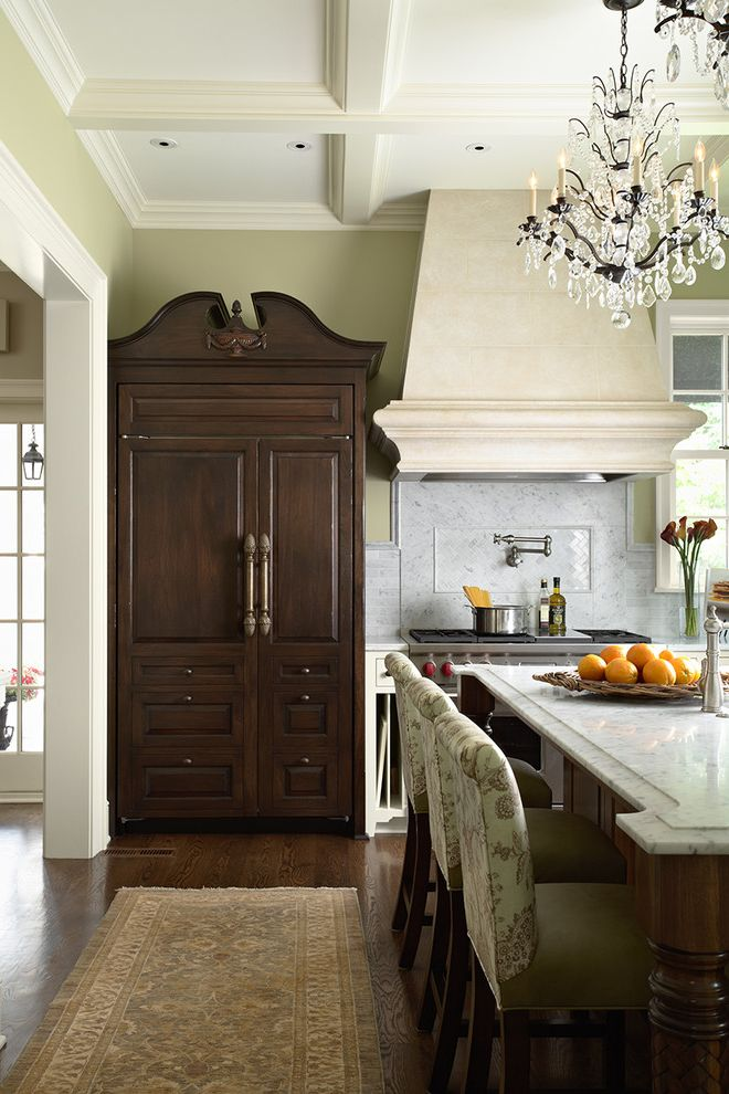 Refrigerator Styles with Traditional Kitchen  and Armoire Carpet Runner Chandelier Coffered Ceiling Counter Stools Dark Stained Wood Green Hood Integrated Kitchen Marble Backsplash Marble Island Pot Filler Wardrobe