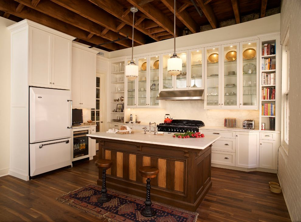 Refrigerator Styles with Traditional Kitchen  and Built in Barstools Carrara Countertops Exposed Beams Glass Cabinets High Ceiling Loft Painted Cabinets Rustic Wood Island Vintage Modern White Countertop White Kitchen White Refrigerator Wood