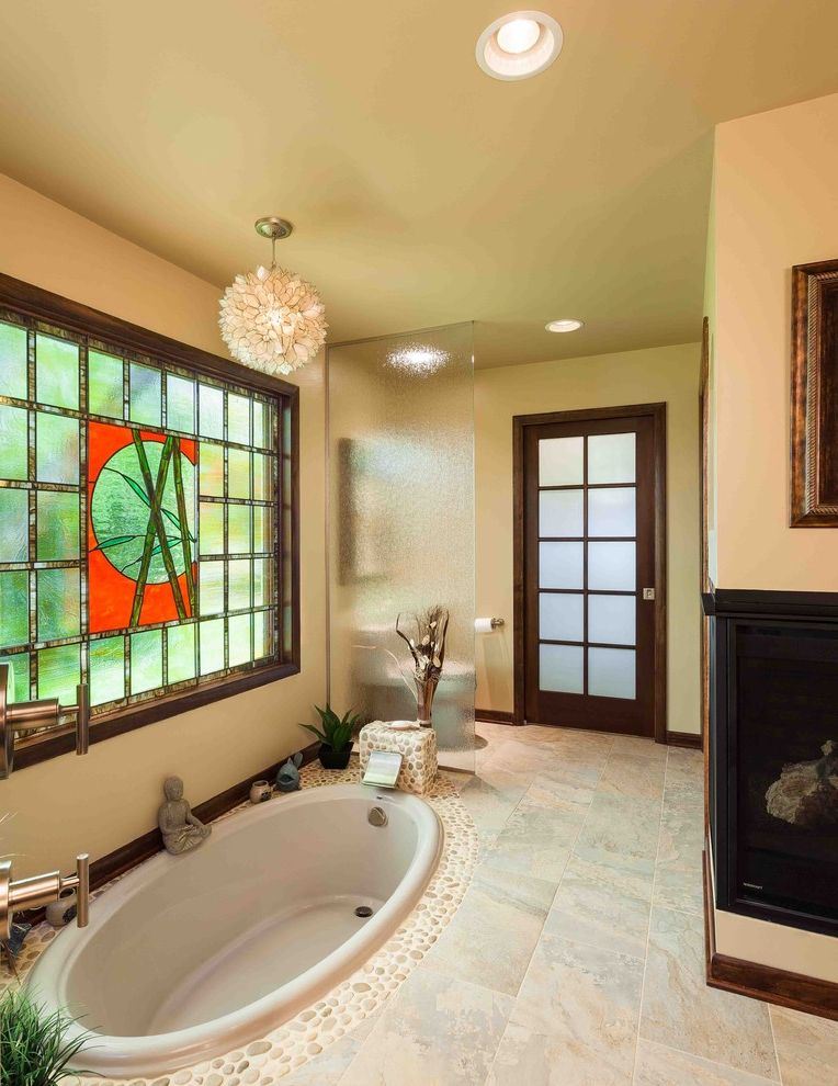 Reglaze Tub Cost with Asian Bathroom Also Ceiling Lighting Fireplace Glass Screen Neutral Colors Painted Ceilings Pebble Tile Recessed Lighting River Stone Stained Glass Stone Floor Sunken Tub Tan Walls