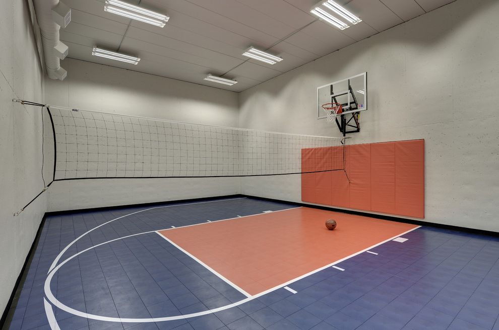 Regulation Volleyball Court with Transitional Home Gym  and Basketball Court Basketball Net Blue and Orange Blue Court Blue Floor Complementary Colors Indoor Basketball Court Orange Pads Sport Court Tube Lights Volleyball Net