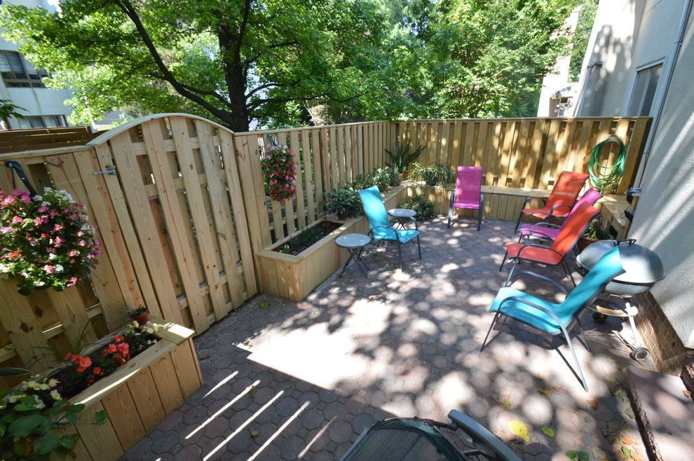 Reisterstown Lumber   Traditional Patio  and Paved Patio Rolland Park Townhouse Back Yard Small Space Design Ideas Wood Fence with Integrated Benches and Outdoor Planters
