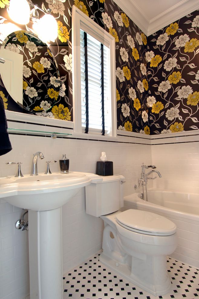 removing wallpaper border eclectic bathroom and black accent strip black and white black and white floor tile crown molding double sconce floral wallpaper glass shelf round mirror tile wainscoting yellow