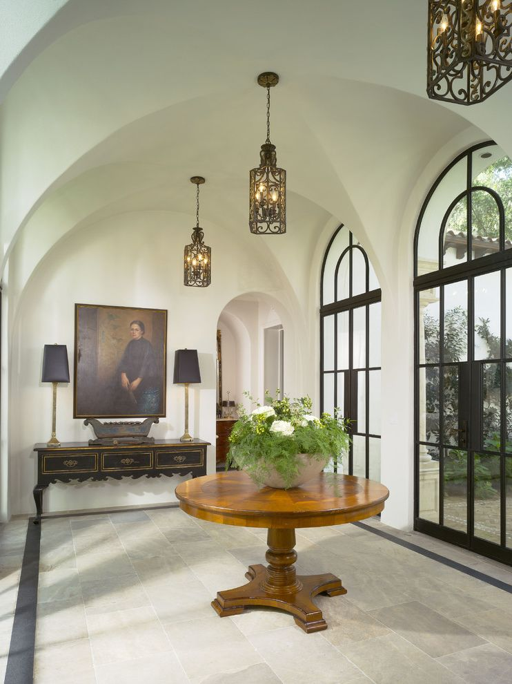 Renaissance Norman Ok   Mediterranean Entry  and Arch Ceiling Lighting Console Table Entry Table Foyer French Doors Glass Doors Hallway Lantern Pendant Lighting Potted Plant Rib Vault Round Table Spanish Stone Flooring Table Lamp Vaulted Ceilings