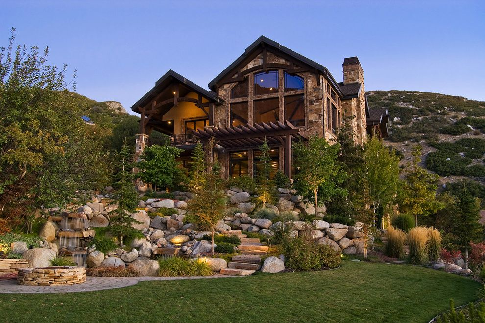 Rent to Own Homes in Utah   Rustic Exterior  and Bbq Pit Boulders Cabin Deck Entrance Entry Fountain Garden Lighting Grass Hillside Lawn Lodge Outdoor Stairs Patio Rocks Slope Trellus Turf View Water Feature Water Fountain Waterfall