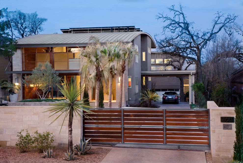 Residential Driveway Gates   Contemporary Exterior  and Covered Parking Gate Gravel Metal Roof Overhang Round Roof Stone Fence Succulent Plants Tropical Windows