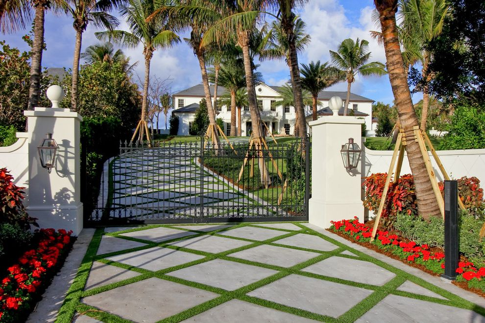 Residential Driveway Gates   Tropical Landscape  and Curved Driveway Entry Gate Flowerbeds Lanterns Latticed Driveway Palm Trees Red Flowers