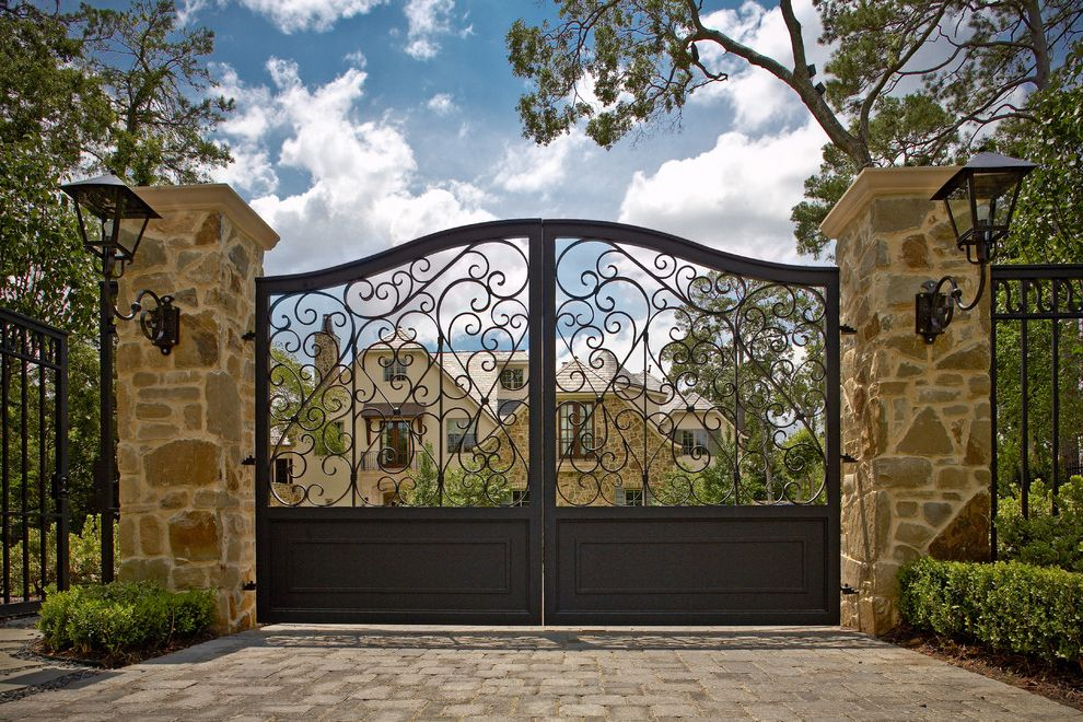 Residential Driveway Gates with Mediterranean Landscape Also Brick Driveway Entry Gate Filagree Jerkinhead Roof Metal Gate Stone Pillars Wall Lantern Wrought Iron Gate Wrought Iron Lighting Fixture